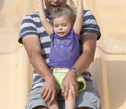 David Foor and his daughter, Audrey, 3, slide down the giant slide at the Montrose Octoberfest. Photo by Ed Hamilton. October 06, 2012